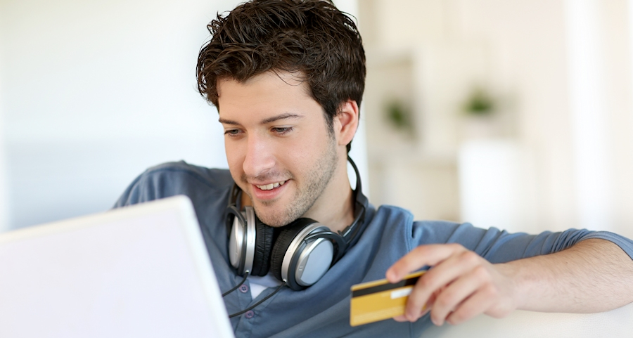 picture of man doing online banking with laptop
