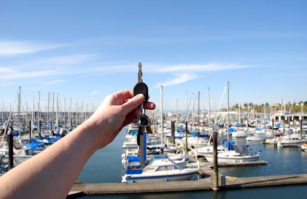 hand holding keys in marina