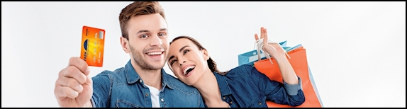 Couple holding VISA orange card sm